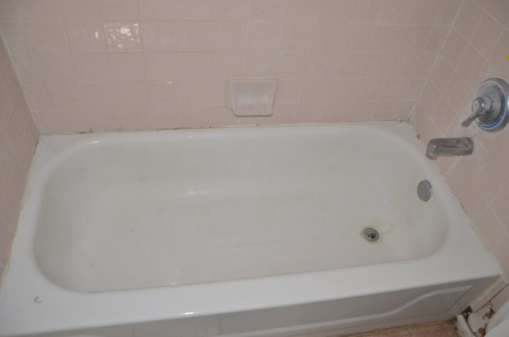 Before: outdated bathroom tile